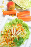 Salad of vegetables and apples stock image