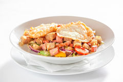 Salad with vegetables, bacon and fried eggs Stock Image