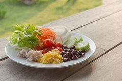 Salad vegetables in breakfast. Salad, healthy meal of the day Stock Image
