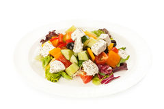 Salad with vegetables and cheese. White background Stock Photography