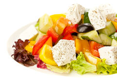 Salad with vegetables and cheese. White background Stock Images