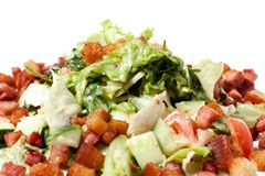 Salad with vegetables and croutons. Salad with vegetables, fried bacon Royalty Free Stock Photos