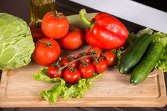 Salad vegetables on the cutting board Stock Image