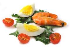 Salad of vegetables, egg and shrimp. Salad of vegetables tomatoes cherry, arugula , eggs with shrimp Stock Image
