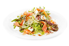 Salad with vegetables,fish and cheese. Royalty Free Stock Image