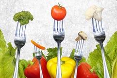 Salad vegetables on forks Royalty Free Stock Photo