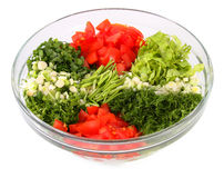 Salad vegetables and greens in a glass vase Stock Photos