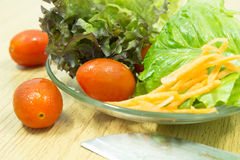 Salad with vegetables and greens. Salad with vegetables greens and tomatos Stock Photos
