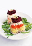 Salad with vegetables and herring Royalty Free Stock Image