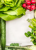 Salad vegetables ingredients around white wooden tray, top view. Place for text royalty free stock photo