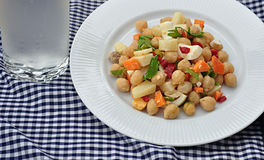 Salad vegetables and legumes. On plate stock photo