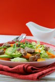Salad with vegetables and meat grilled Stock Images
