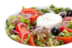 Salad with vegetables, olives and cheese. White background Royalty Free Stock Image