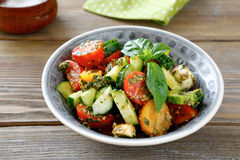 Salad with vegetables and pesto in bowl Stock Photo