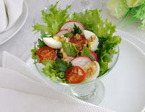 Salad of vegetables with quail eggs Stock Photos