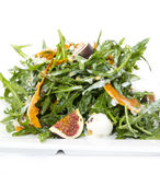 Salad with vegetables and seafood. Salad of arugula figs and cheese on white background royalty free stock photos