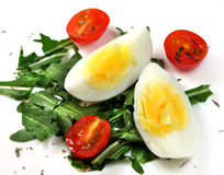 Salad of vegetables - tomatoes, rucola and eggs Royalty Free Stock Image