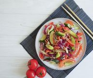 Salad, vegetarian chinese food tomato fresh green nutrition health on a wooden background table royalty free stock photography