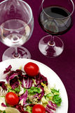 Salad with vine. Summer salad with red vine and water Royalty Free Stock Photo