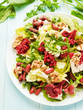 Salad with walnuts and various herbs Stock Images