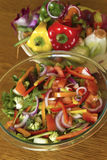Salad and Wasted Vegetable Scraps Royalty Free Stock Image