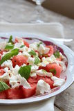Salad of watermelon and cheese. On a wooden table stock images