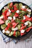 Salad with watermelon, cucumber and arugula closeup. vertical to Royalty Free Stock Photography