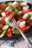 Salad of watermelon, feta, arugula and cucumbers closeup. Vertic Stock Photography