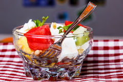 Salad of watermelon, kiwi, cheese, pine nuts - an easy summer de Royalty Free Stock Photo