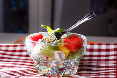 Salad of watermelon, kiwi, cheese, pine nuts - an easy summer de Stock Images