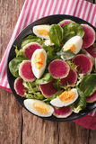 Salad of watermelon radishes, eggs, spinach and lettuce mix clos Royalty Free Stock Image