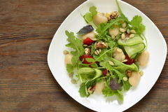 Salad with white beans, greens, cucumbers and sweet peppers Stock Photography
