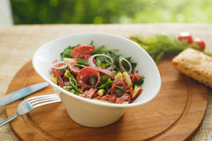 Salad in white bowl on a background of nature Stock Photography