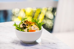 Salad. In a white bowl with bokeh background Stock Image