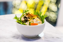 Salad. In a white bowl with bokeh background Stock Photo