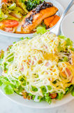 Salad. In white bowl on the table Stock Photography