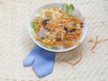 Salad. In a white dish on wood and clay Royalty Free Stock Photo