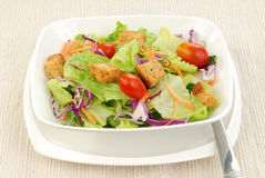 Salad on a white placemat Royalty Free Stock Image