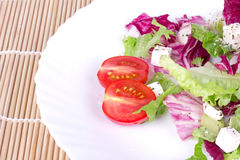 Salad on white plate Royalty Free Stock Image