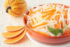 Salad of white radish with pumpkin Stock Photography
