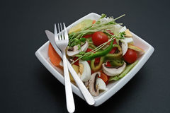 Salad on white square plate Royalty Free Stock Image