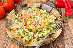 Salad With Bulgur, Zucchini, Tomatoes And Parsley On The Plate Stock Photos