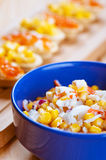 Salad With Corn In Blue Plate Stock Photos