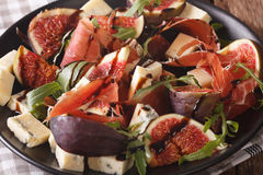 Salad With Figs, Prosciutto, Cheese And Arugula Macro On A Plate Royalty Free Stock Images
