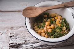 Salad With Fusilli, Chickpeas And Peas In A White Bowl Royalty Free Stock Photo