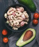 Salad With Shrimp, Avocado And Tomato Sauce In A Black Dish.