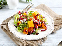 Free Salad With Slices Of Pumpkin And Sesame Seeds Royalty Free Stock Image - 53039896
