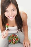 Salad woman eating healthy Stock Photos