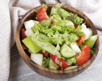 Salad. In a wooden bowl, fresh vegetables with apple Stock Photo