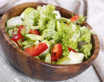 Salad. In a wooden bowl, fresh vegetables with apple Stock Photos